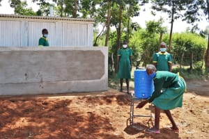 The Water Project: St. Peters Bwanga Primary School -  Using A New Handwashing Station