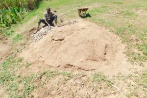 The Water Project: Emusaka Community, Muluinga Spring -  Breaking Rocks Into Gravel