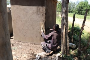 The Water Project: St. Peters Bwanga Primary School -  Plastering Latrine Walls