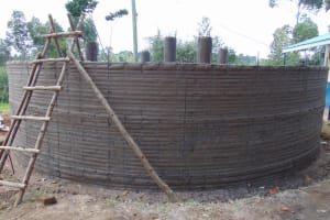 The Water Project: Jamulongoji Primary School -  Rain Tank Wall Underway
