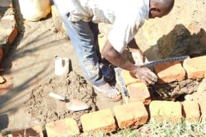 The Water Project: Emusaka Community, Muluinga Spring -  Bricklaying