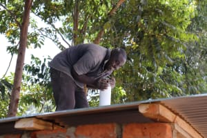 The Water Project: St. Peters Bwanga Primary School -  Fitting The Flytrap On Latrine Vent