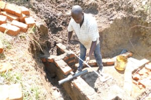 The Water Project: Emusaka Community, Muluinga Spring -  Setting The Pipe