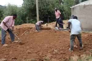 The Water Project: Jamulongoji Primary School -  Leveling Ground Around Tank