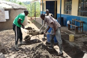 The Water Project: Jamulongoji Primary School -  Loading Sand And Cement Mixture