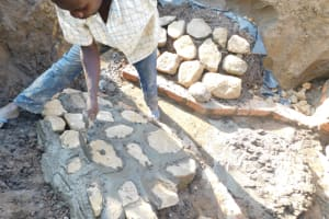 The Water Project: Emusaka Community, Muluinga Spring -  Plastering The Stone Pitching