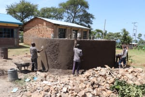 The Water Project: St. Peters Bwanga Primary School -  Plastering The Outside Of The Tank