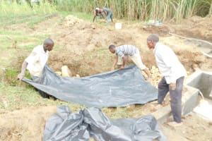 The Water Project: Emusaka Community, Muluinga Spring -  Fitting The Tarp