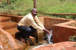The Water Project: Mutao Community, Kenya Spring -  Enjoying Water At The Spring