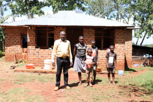 The Water Project: Mutao Community, Kenya Spring -  Jacob With His Grandchildren At Home