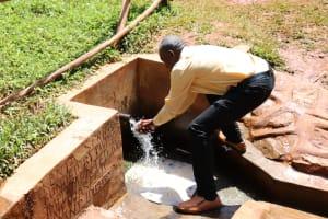 The Water Project: Mutao Community, Kenya Spring -  Handwashing At The Spring