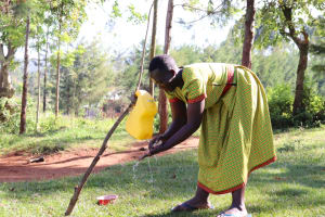 The Water Project: Mbande Community, Handa Spring -  Sarah Washing Her Hands