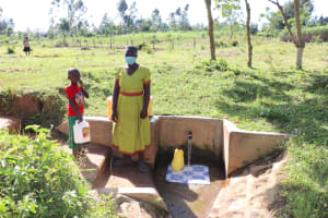 The Water Project: Mbande Community, Handa Spring -  Sarah With Her Son At The Spring