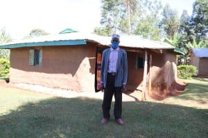 The Water Project: Namarambi Community, Iddi Spring -  Asman Outside His Home