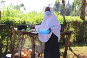 The Water Project: Namarambi Community, Iddi Spring -  Washing Dishes With Spring Water