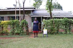 The Water Project: Shisere Community, Richard Okanga Spring -  Christine Outside Her Home