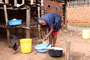 The Water Project: Shisere Community, Richard Okanga Spring -  Using Spring Water To Wash Dishes