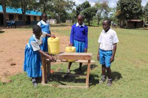 The Water Project: Jamulongoji Primary School -  Demonstrating Handwashing Station Use