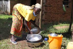 The Water Project: Jamulongoji Primary School -  Ebby Washing Utensils With Tank Water