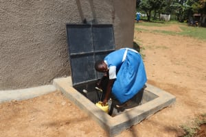 The Water Project: Jamulongoji Primary School -  Student Collecting Water