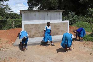 The Water Project: Jamulongoji Primary School -  Pupils Clean Rubbish Around The Latrine