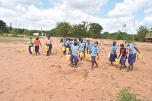 The Water Project: Mang'uu Primary School -  Kenya Pupils Carrying Water