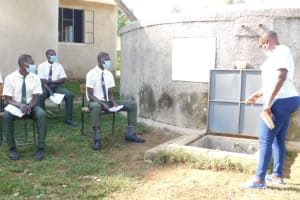 The Water Project: ACK St. Peter's Khabakaya Secondary School -  Trainer Jacky Leads Site Management At The Rain Tank