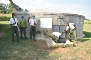 The Water Project: ACK St. Peter's Khabakaya Secondary School -  Boys Pose With The Rain Tank