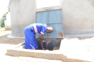 The Water Project: Eshimuli Primary School -  Irine Gets A Drink From The Rain Tank