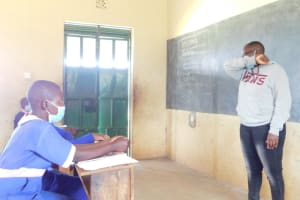The Water Project: Eshimuli Primary School -  Trainer Jackline Showing The Elbow Sneeze