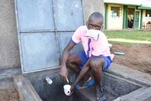 The Water Project: Eshimuli Primary School -  Getting A Fresh Drink From The Rain Tank