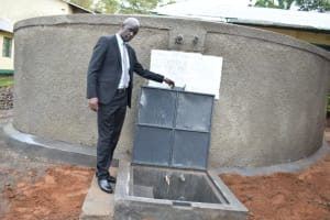 The Water Project: Makunga Secondary School -  Principal Posing With The Rain Tank