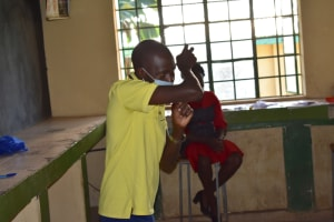 The Water Project: Makunga Secondary School -  Trainer Protus Showing The Elbow Sneeze