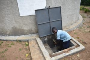 The Water Project: Isango Primary School -  A Student At The Water Point