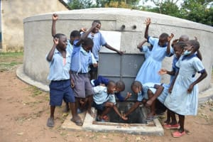 The Water Project: Isango Primary School -  Children Celebrating