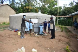 The Water Project: Isango Primary School -  Field Officer Julius Hands Over The Tank To The School