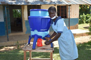 The Water Project: Isango Primary School -  Lucy Gets A Drink From A Filter