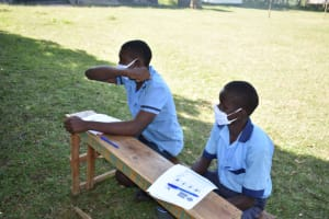 The Water Project: Isango Primary School -  Showing The Elbow Cough
