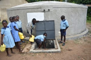 The Water Project: Isango Primary School -  Students Fetching Water