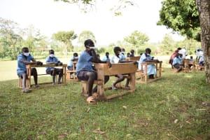 The Water Project: Isango Primary School -  Students Listening At Training