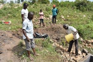 The Water Project: Bukalama Community, Wanzetse Spring -  Layering Smaller Stones