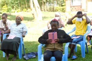 The Water Project: Bukalama Community, Wanzetse Spring -  Renson Puts On A Mask