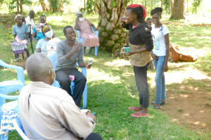 The Water Project: Bukalama Community, Wanzetse Spring -  Snaider Demonstrates Toothbrushing