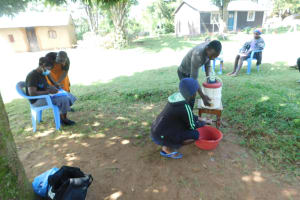 The Water Project: Bukalama Community, Wanzetse Spring -  Terry Takes Part In Handwashing