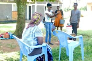 The Water Project: Bukalama Community, Wanzetse Spring -  Trainer Elvine Demonstrates Handwashing