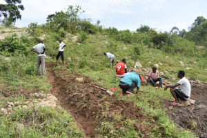 The Water Project: Bukalama Community, Wanzetse Spring -  Digging A Diversion Channel Above The Spring