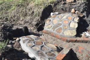 The Water Project: Bukalama Community, Wanzetse Spring -  Plastered Stone Pitching