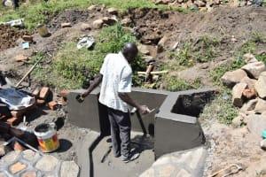 The Water Project: Bukalama Community, Wanzetse Spring -  Plastering Spring Walls