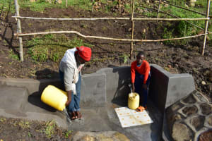 The Water Project: Bukalama Community, Wanzetse Spring -  Rinsing The Stairs And Collecting Water