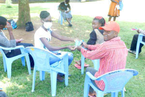 The Water Project: Bukalama Community, Wanzetse Spring -  Victor Receives A Mask
